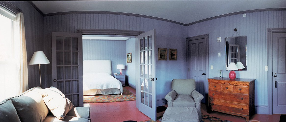 A spacious bedroom with a separate bedroom, a seating area, and more at the Porches Inn near MASS MoCa