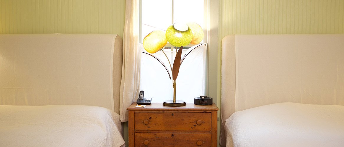 Floral lamp between two beds at our hotel in North Adams