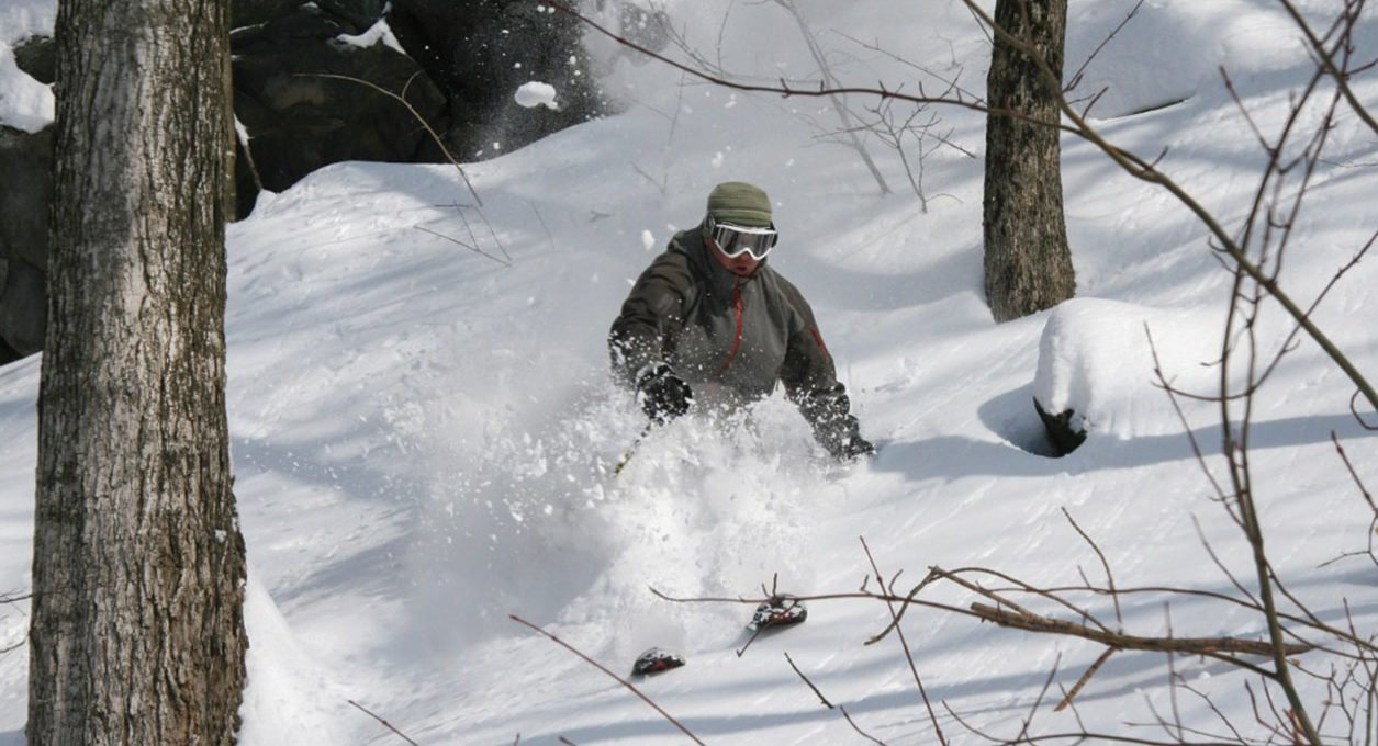 Man skiing powder in the Berkshires near Porches Inn.