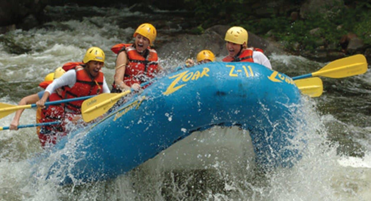 Group white water rafting in the Berkshires.