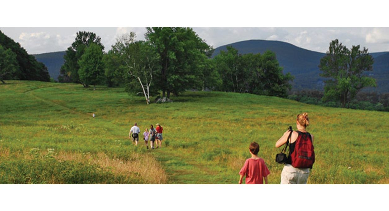 Family hiking along a trail in the Berkshires near Porches Inn.