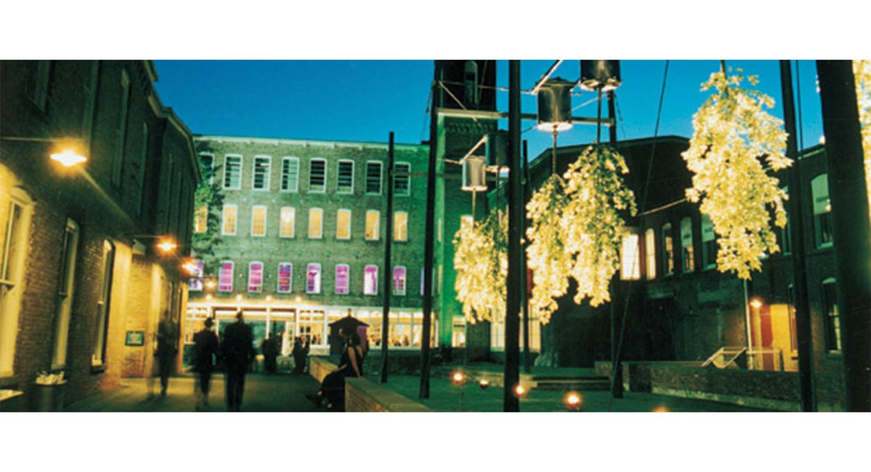 MASS MoCA building courtyard lit up at night.