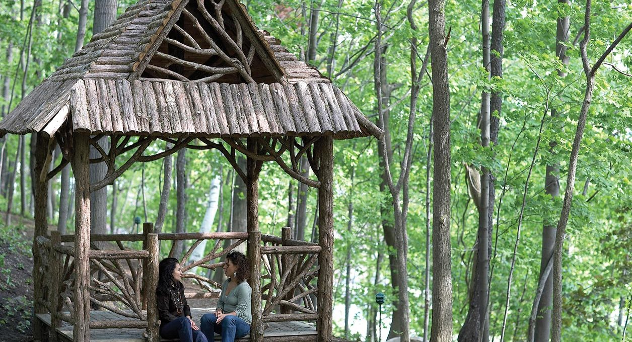 Two guests chat at the rustic gazebo at our hotel near mass moca