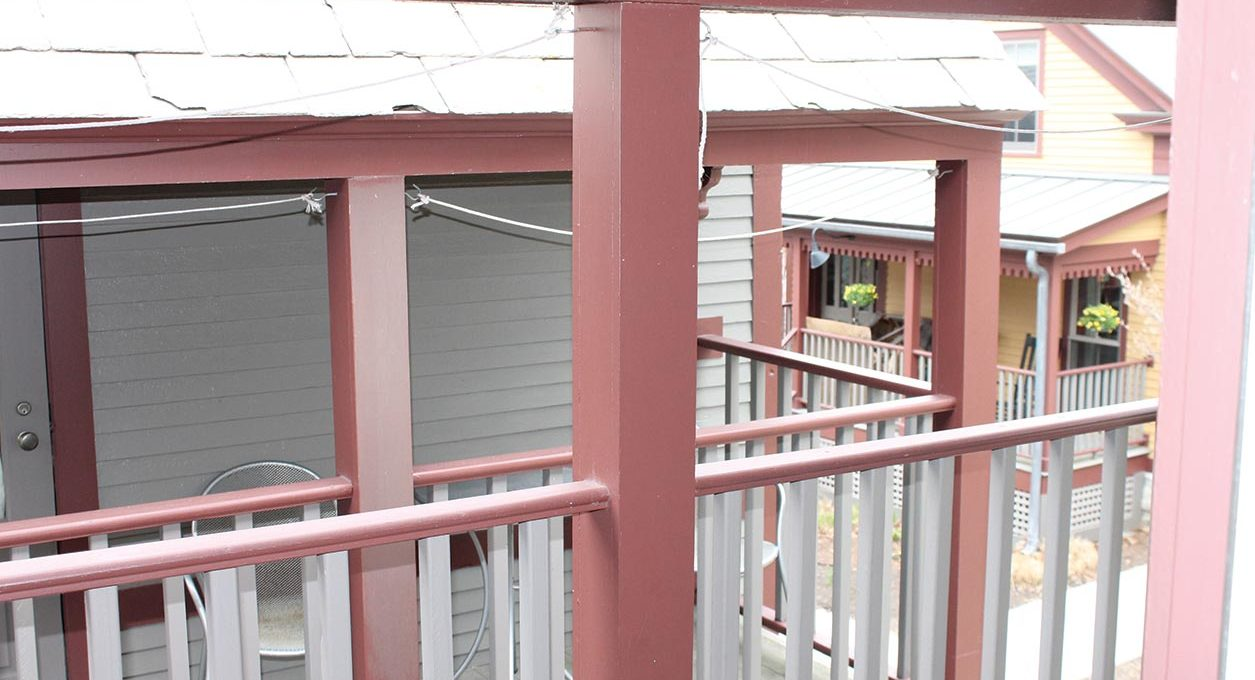 Pink and white balcony at Porches Inn.
