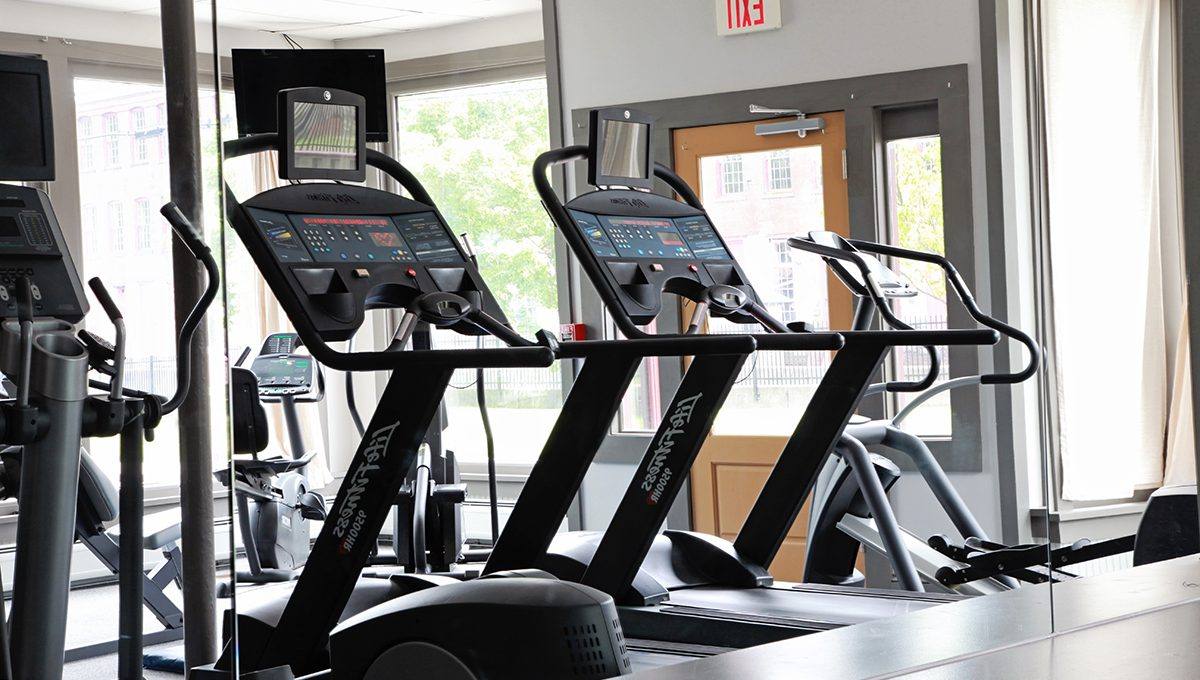Row of treadmills at the fitness center at Porches Inn.